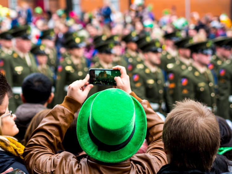 people taking photos at a st patricks day parade