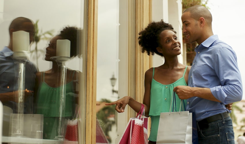 a young couple look at a window display at the Florida Mall in orlando florida