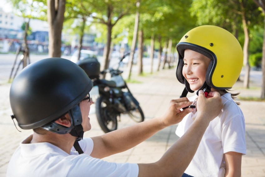 Two people practicing bike safety