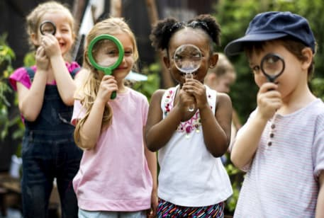 Kids on a field trip with magnifying glasses