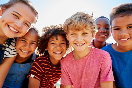 a group of kids smiling