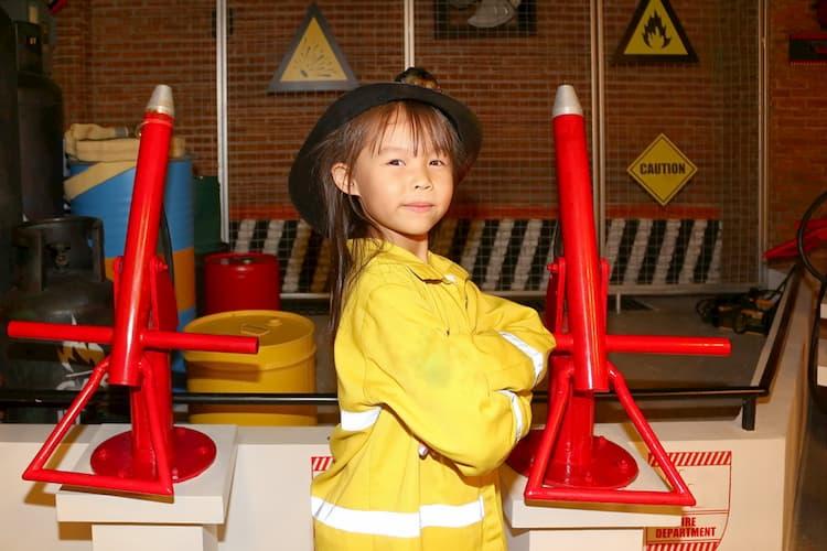 Little girl dressed up as firefighter