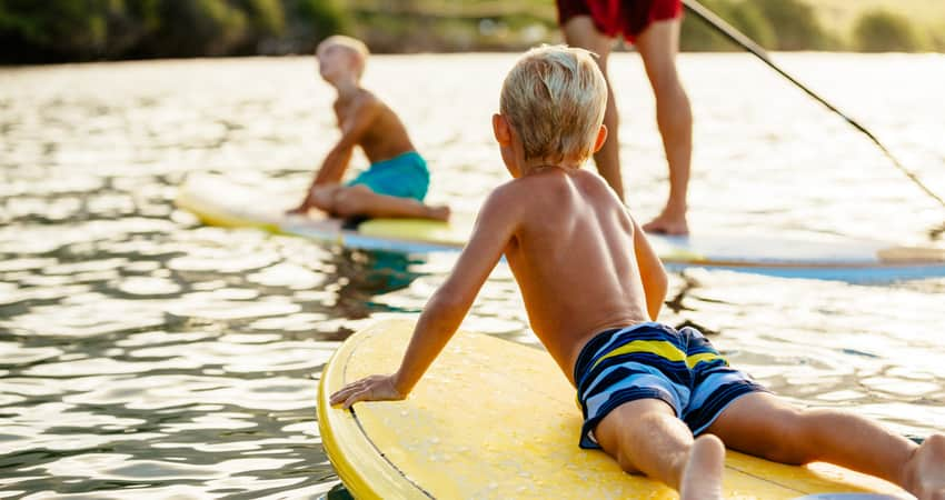 Children and parents paddleboarding