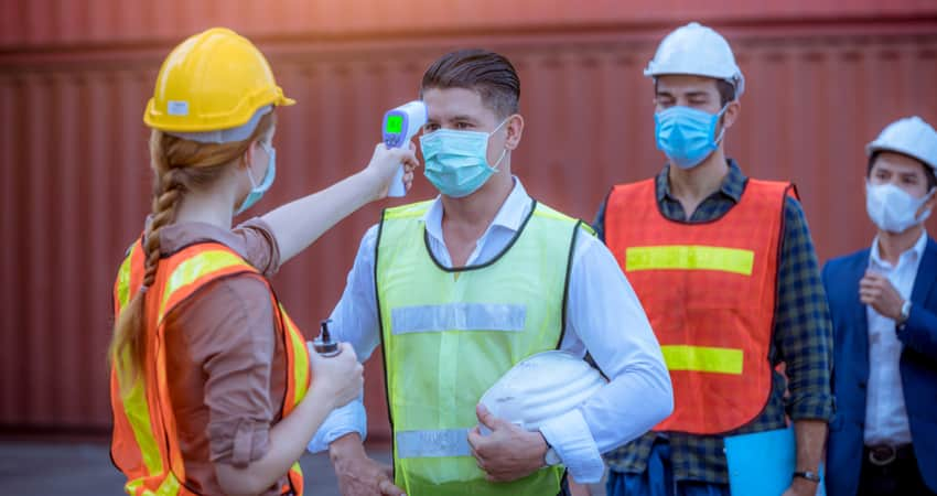 People being temperature screened at a construction site