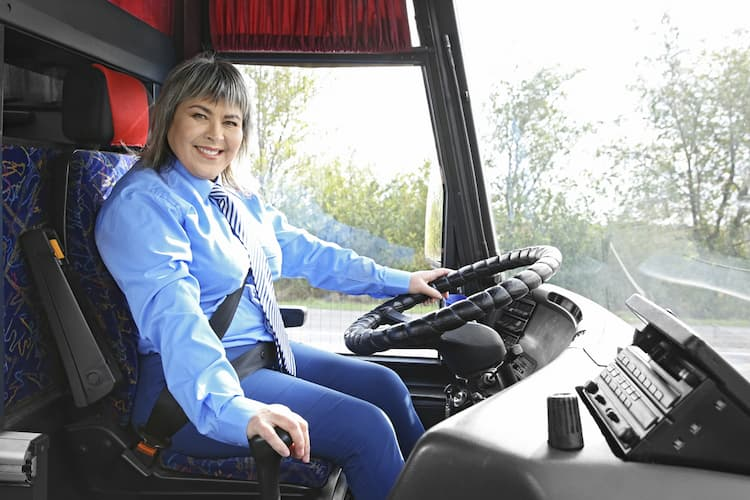 Woman driving bus
