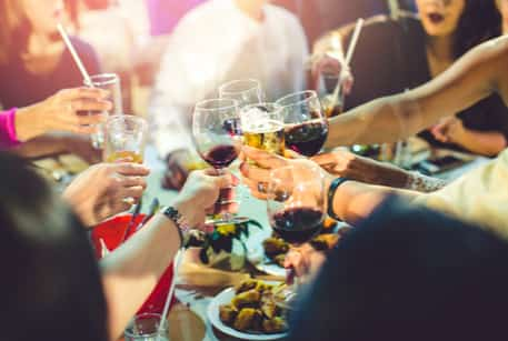 Close up of people toasting wine