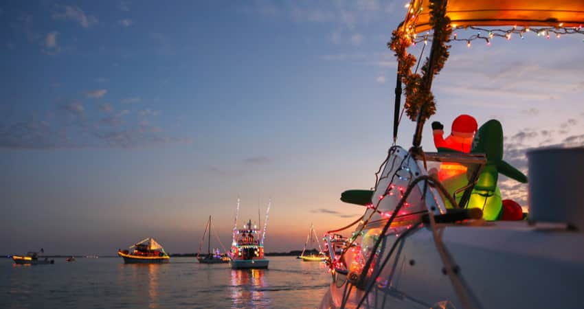 View from a decorated boat for a holiday boat parade at sunset